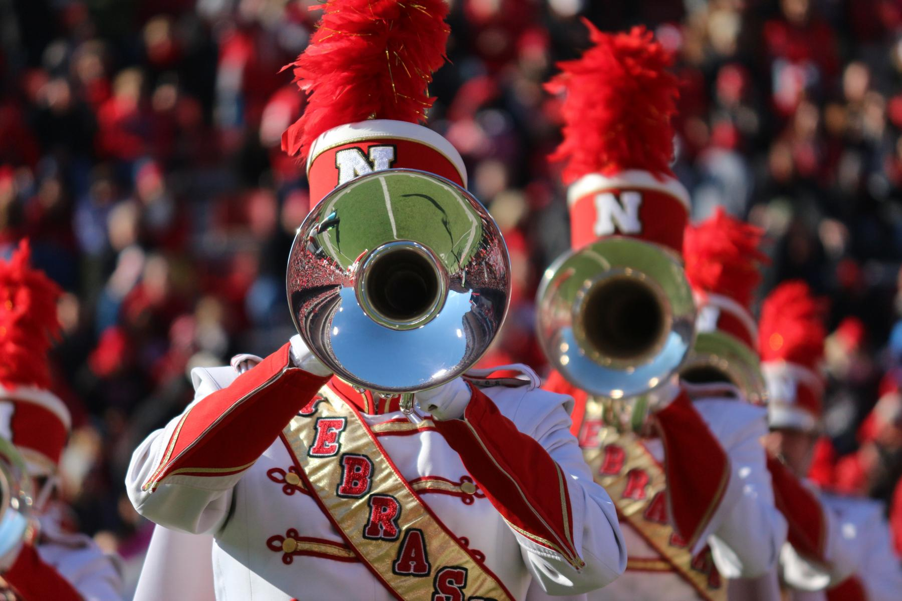 Photo of Cornhusker Marching Band mellophone players at Memorial Stadium.