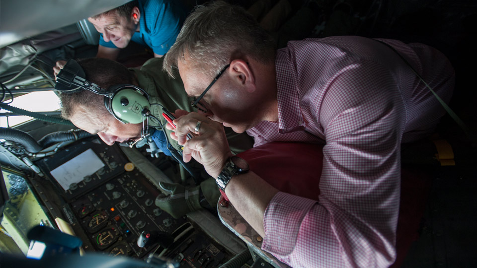 Chancellor Ronnie Green (front) and NU President Hank Bounds (back) observe refueling operations from the Stratotanker cockpit during the civic leader flight.