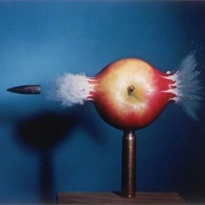 Image captured of bullet piercing apple.