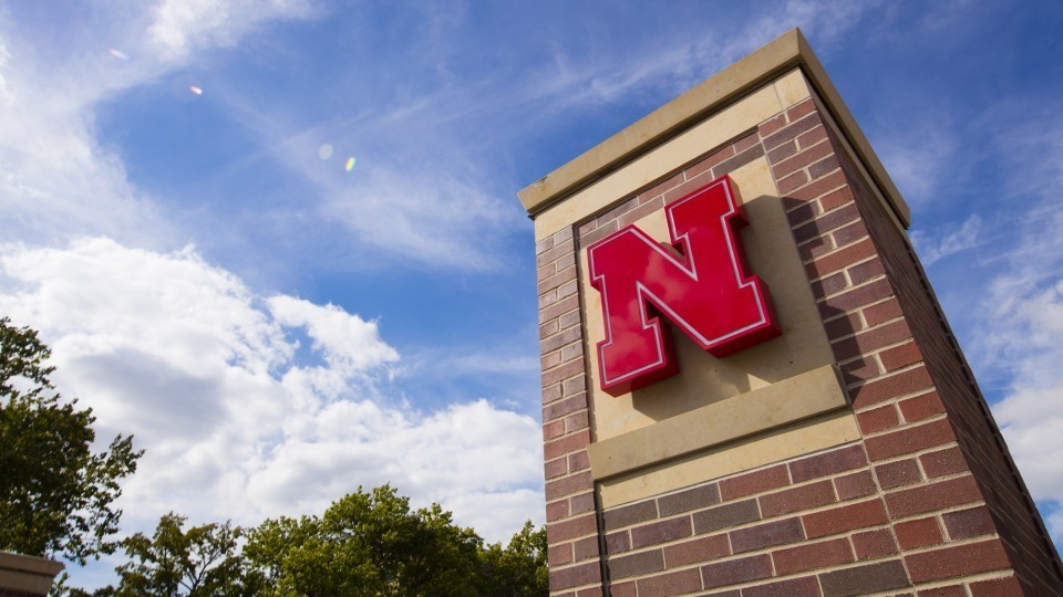 Pillar with Nebraska N; links to news story Knoll Lecture analyzes #MeToo campaign
