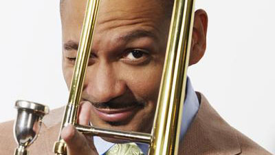 Photo of Delfeayo Marsalis posing with his trombone; links to news story Jazz trombonist to present free lecture