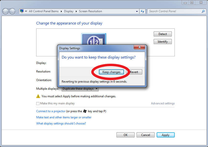 Windows 7 screenshot showing the prompt to keep new display settings