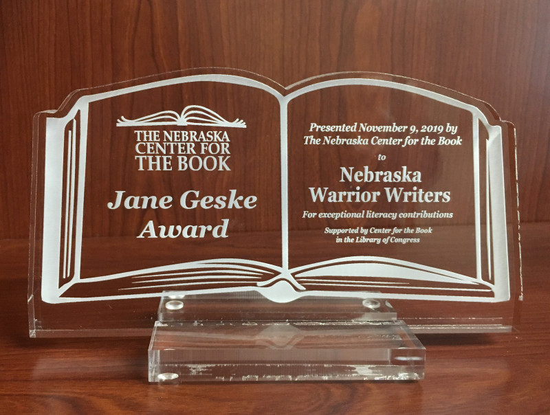 Jane Geske Award acrylic book; links to news story