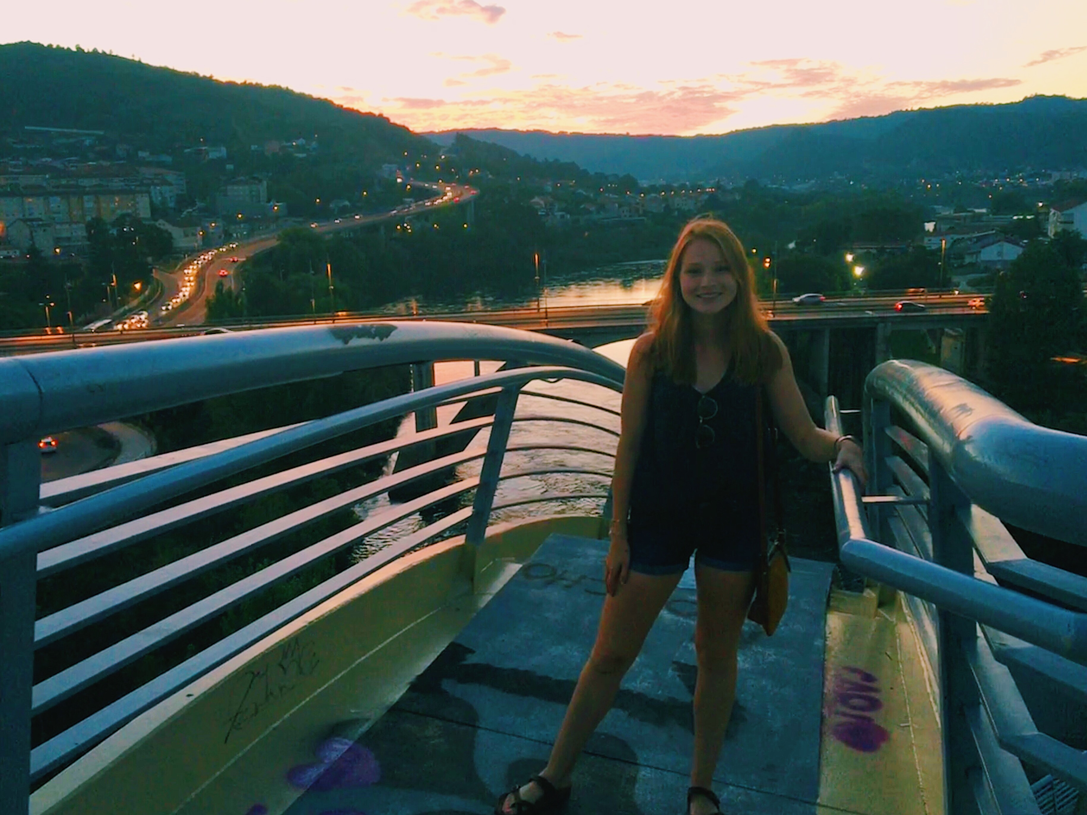 Emma Himes on a footbridge outside Ourense, Spain; links to news story Himes begins Fulbright English Teaching Assistantship in Spain