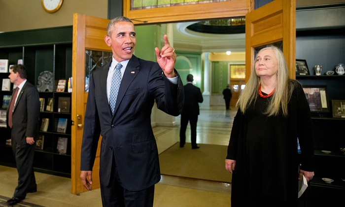 Barack Obama arriving at the State Library of Iowa to interview Marilynne Robinson (right).