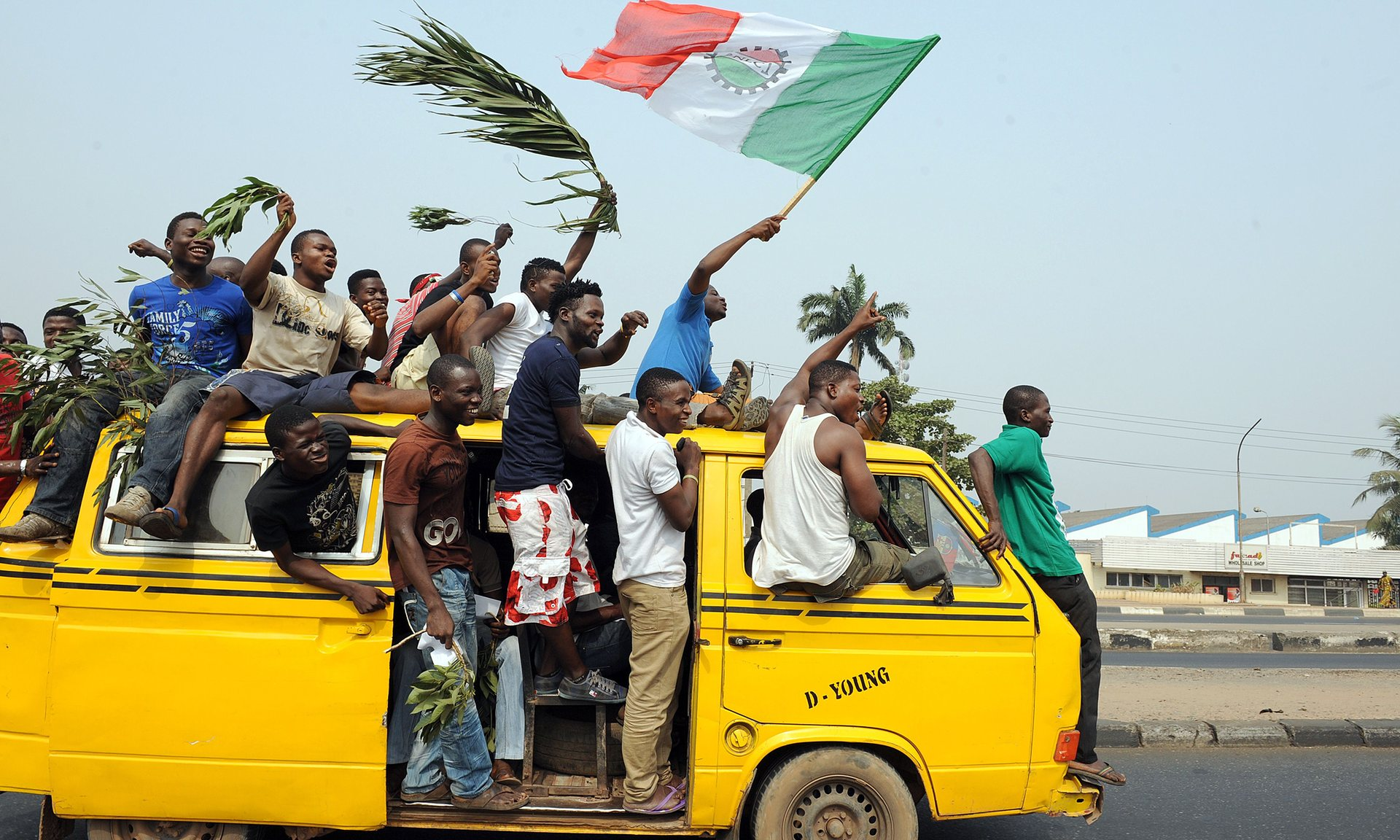A Lagos bus or molue full of people.