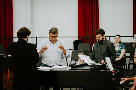 Tyler White (center) rehearses with Patrick McNally (left) and Matthew Gerhold.