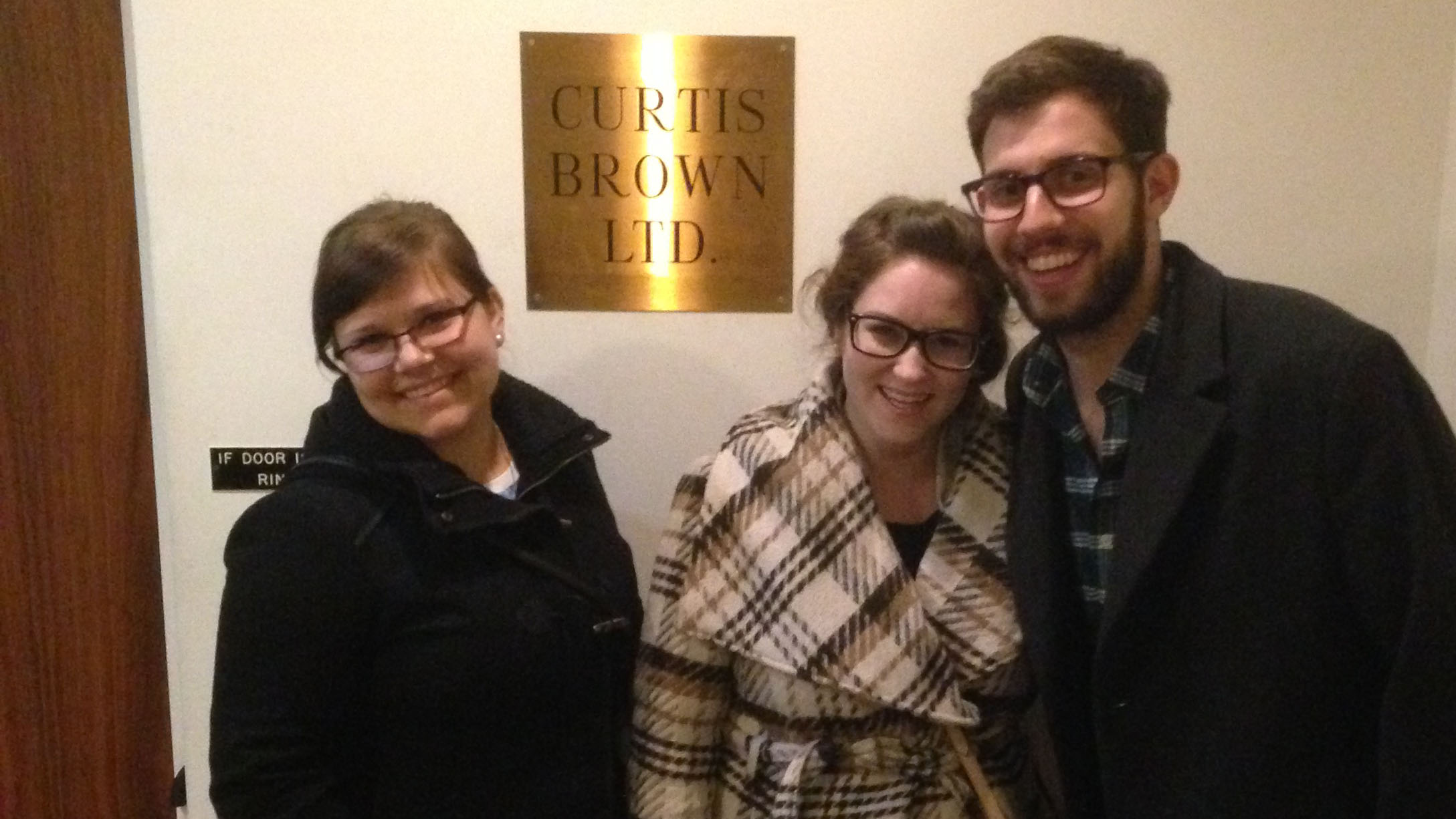 Three UNL undergraduates pose outside the Curtis Brown Ltd. offices in New York City
