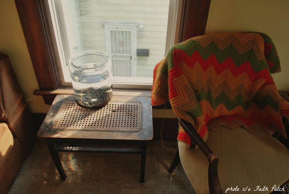 Cover image from latest issue of Red Paint Hill Journal - an arm chair and side table
