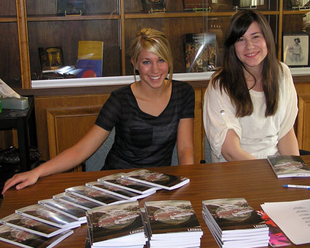 Previous years' Laurus editors distributing copies