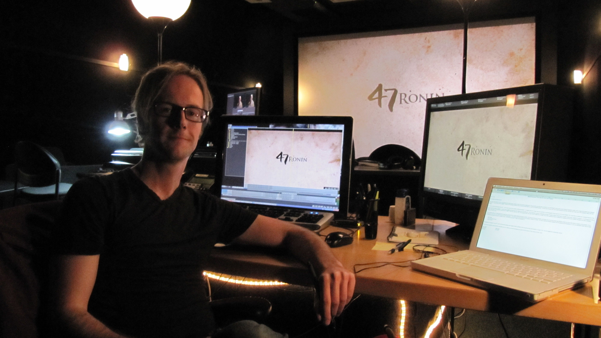 Tom Cabela poses in his office backed by editing software and equipment for 47 Ronin