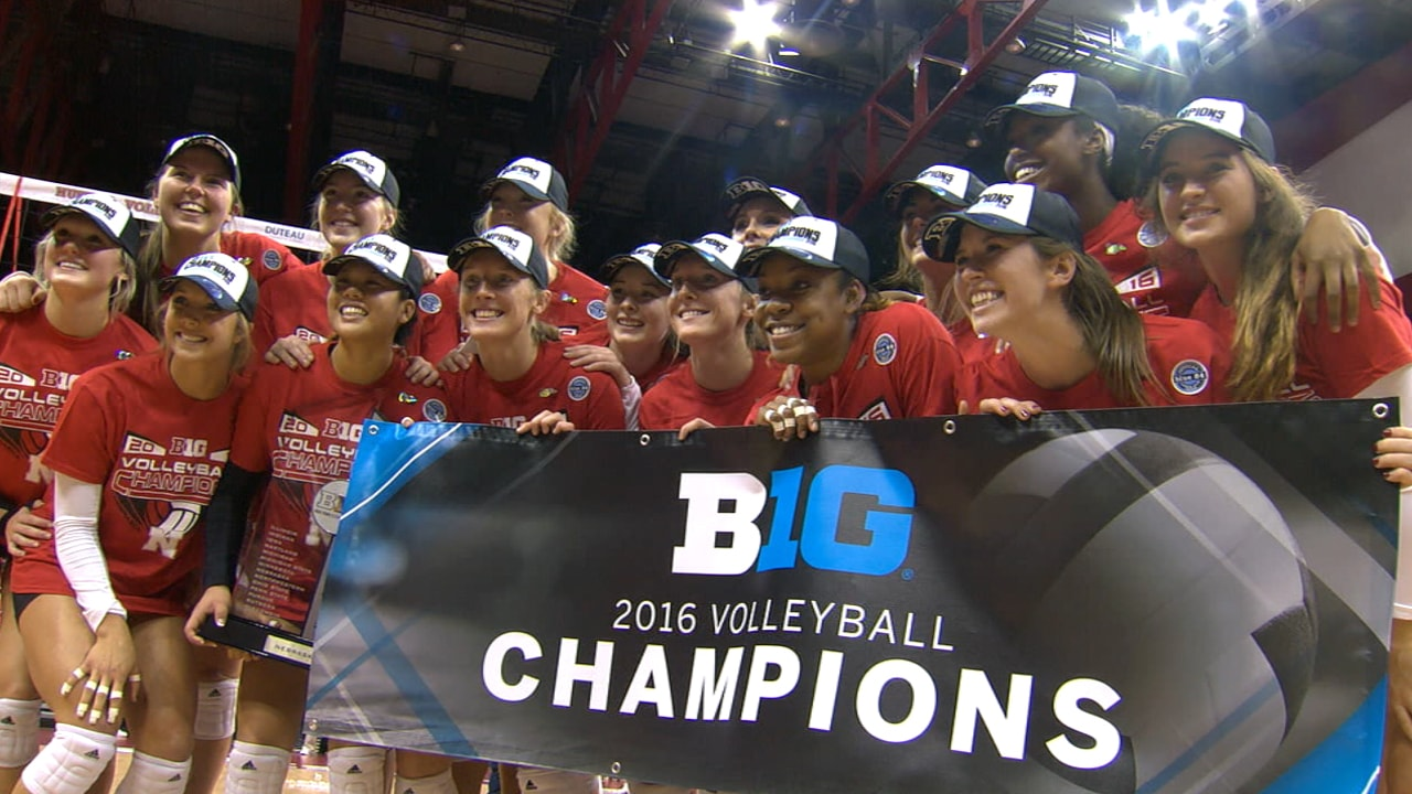 The Nebraska volleyball team holds up a banner that reads Big Ten 2016 Volleyball Champions