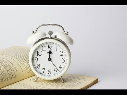 Alarm clock on a book