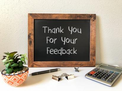 chalkboard with thank for your feedback written on it