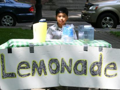 A young entrepreneur selling lemonade on a hot day