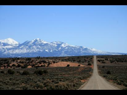 A road extending through plains to the mountains