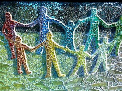 colorful people holding hands