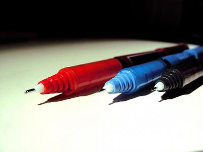 red, blue, and black pens