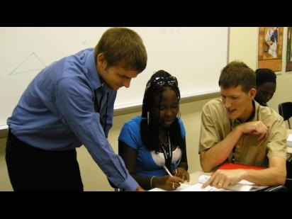 A graduate TA works with a student