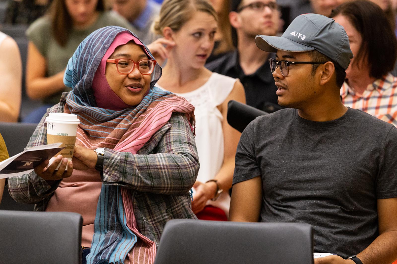 New graduate students conversing at graduate student orientation.
