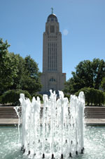 Photo of Nebraska state capitol building with fountain in foreground