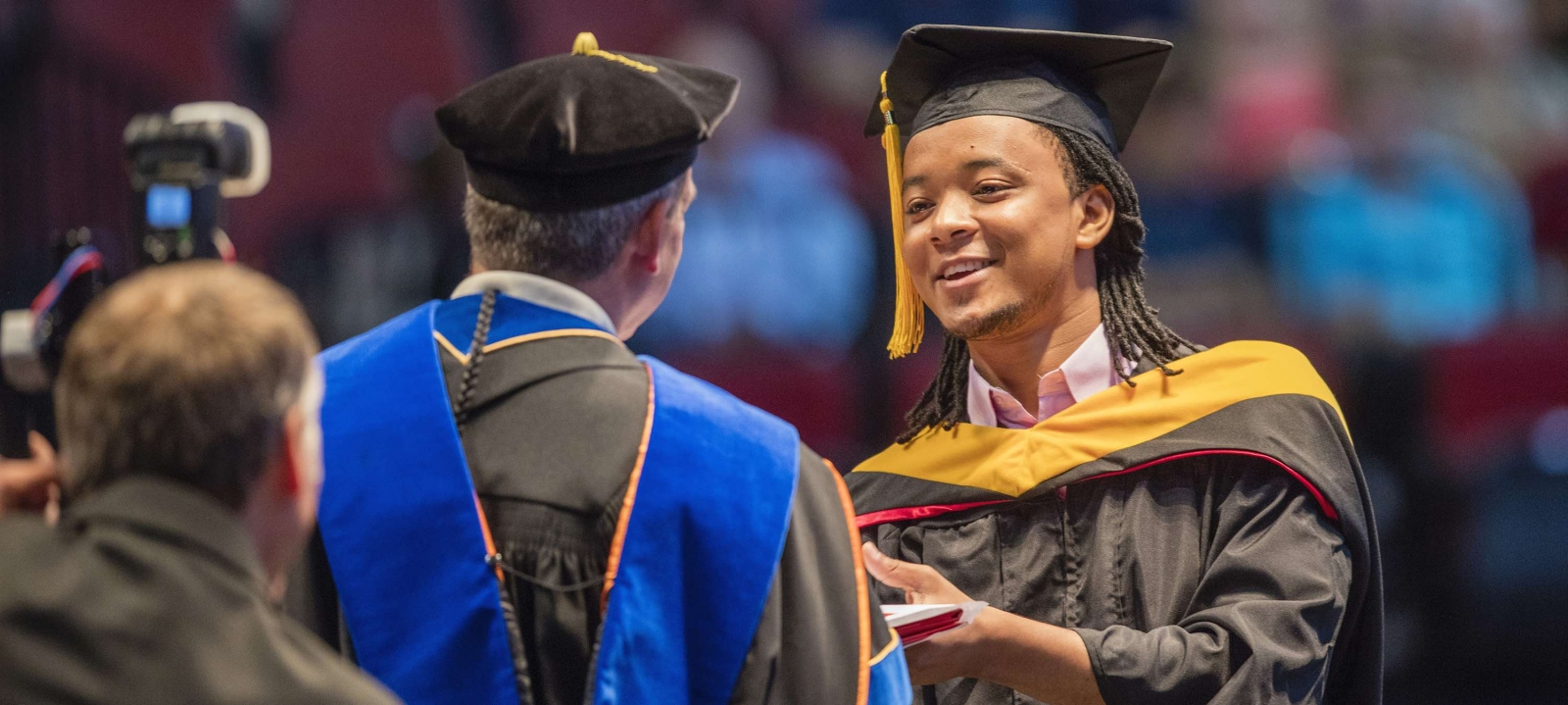 Student receiving diploma at graduation.