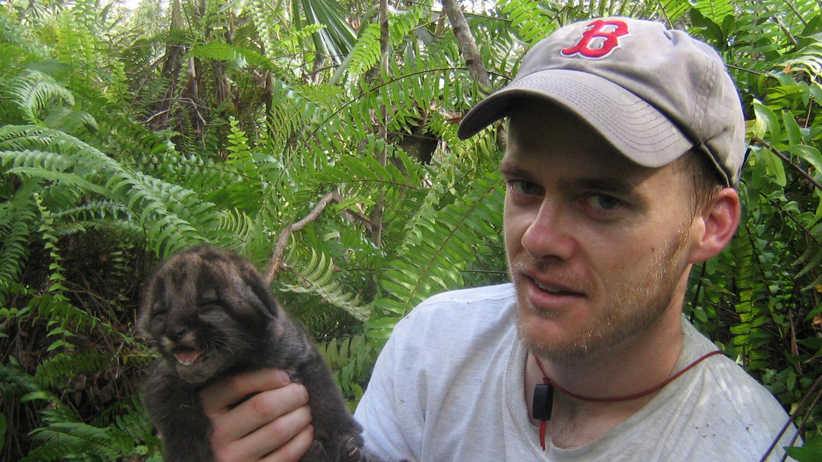 John Benson holding baby panther