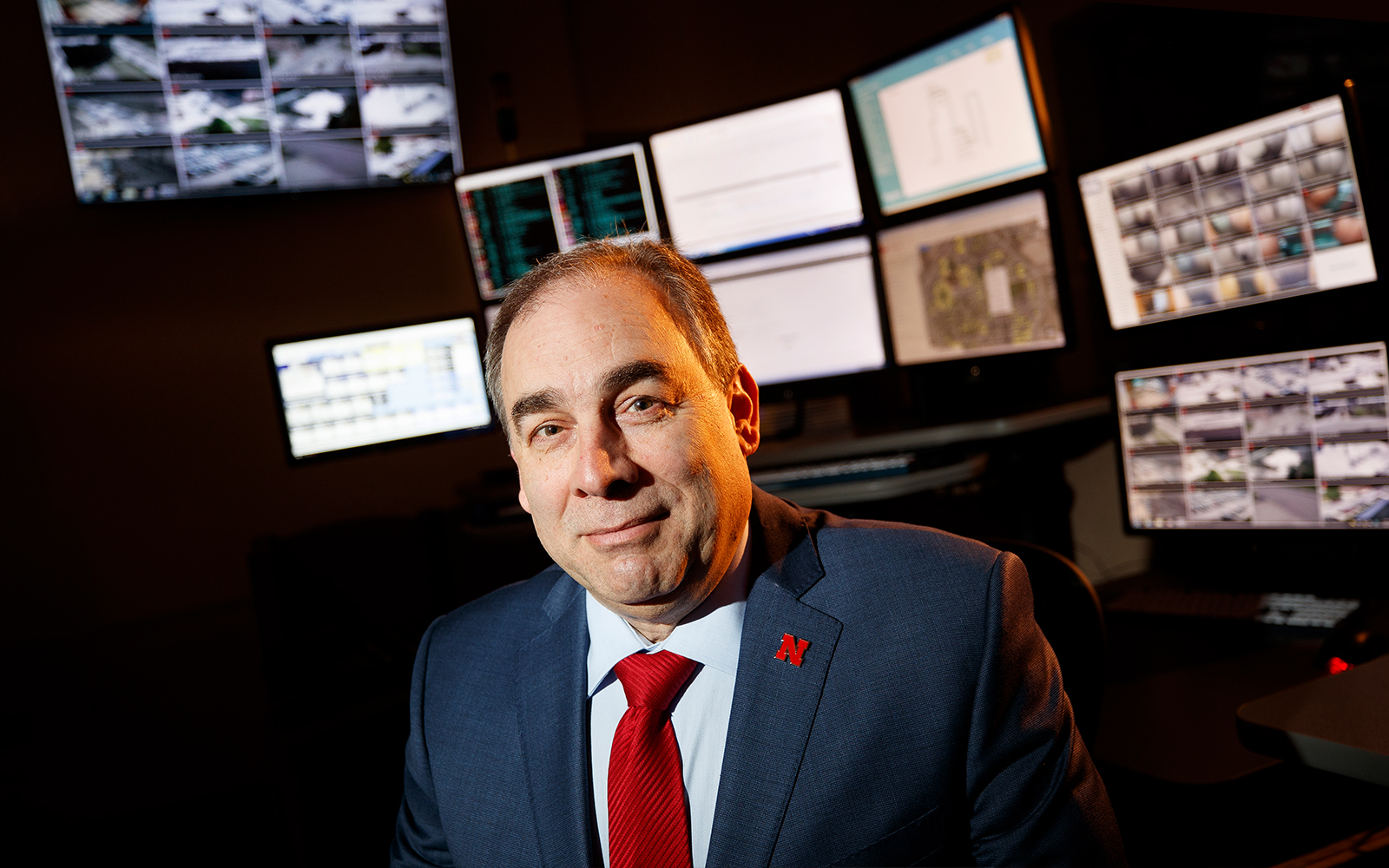 Mario Scalora poses in front of computer screens