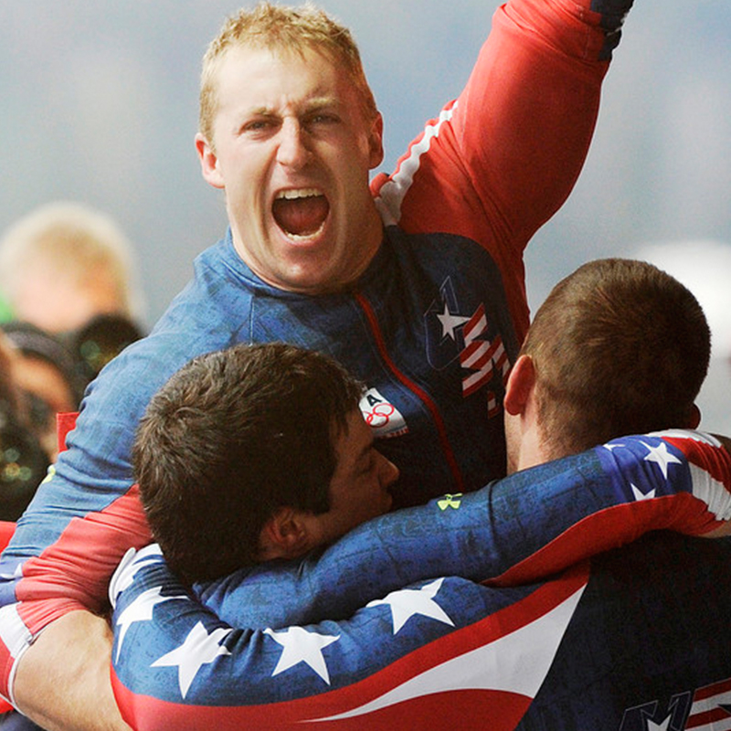 Tomasevicz celebrates with USA-1 teammates after their gold medal finish in the four-man bobsled final at the 2010 Winter Olympics in Vancouver, Canada