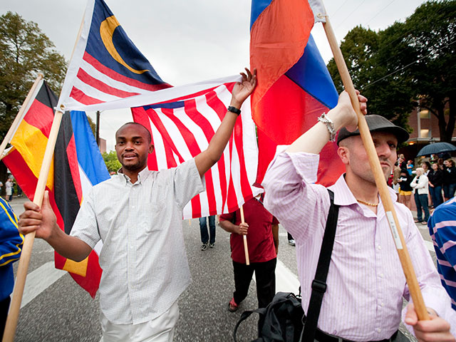 The Cultural Ambassadors of the International Student Organization carry flags of UNL students from foreign countries.