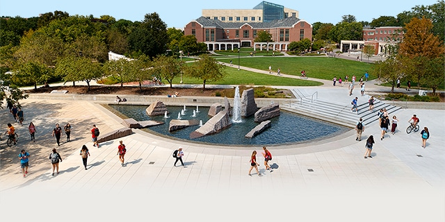 Aerial view of students walking past Broyhill Fountain in the plaza north of the Nebraska Union.