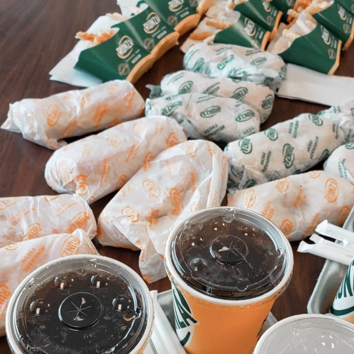 A table full of Runzas and french fries
