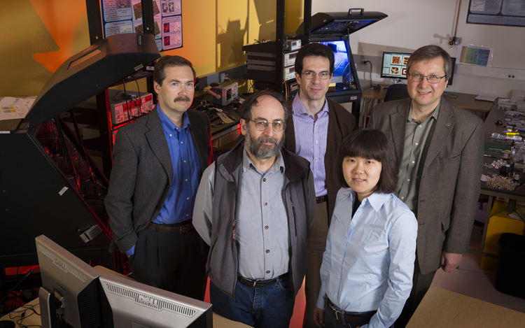 UNL physicists (from left) Alexei Gruverman; Peter Dowben, CNFD associate director; Kirill Belashchenko; Xia Hong, and Evgeny Tsymbal, CNFD director. Not pictured, Christian Binek