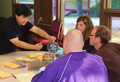 Dr. Zheng at NATS Conference 2011 demonstrating Nanotubes