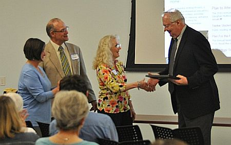 Robert Bussman receives award from Deb Coyle