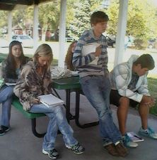 Student writers in picnic shelter