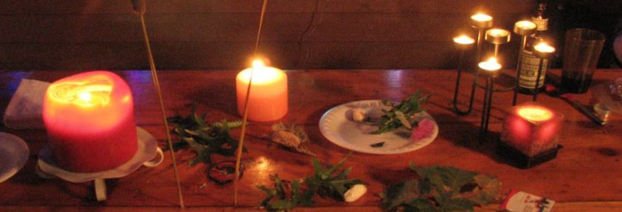 Table with lit candles and trinkets