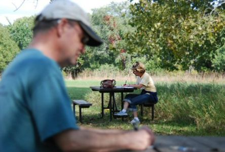 Robert Brooke and Mary Klucas writing in the sunshine at Platte River State Park