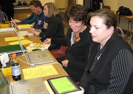 Writers Collaborate at Laptops