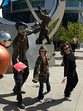 Statue of mimes with people