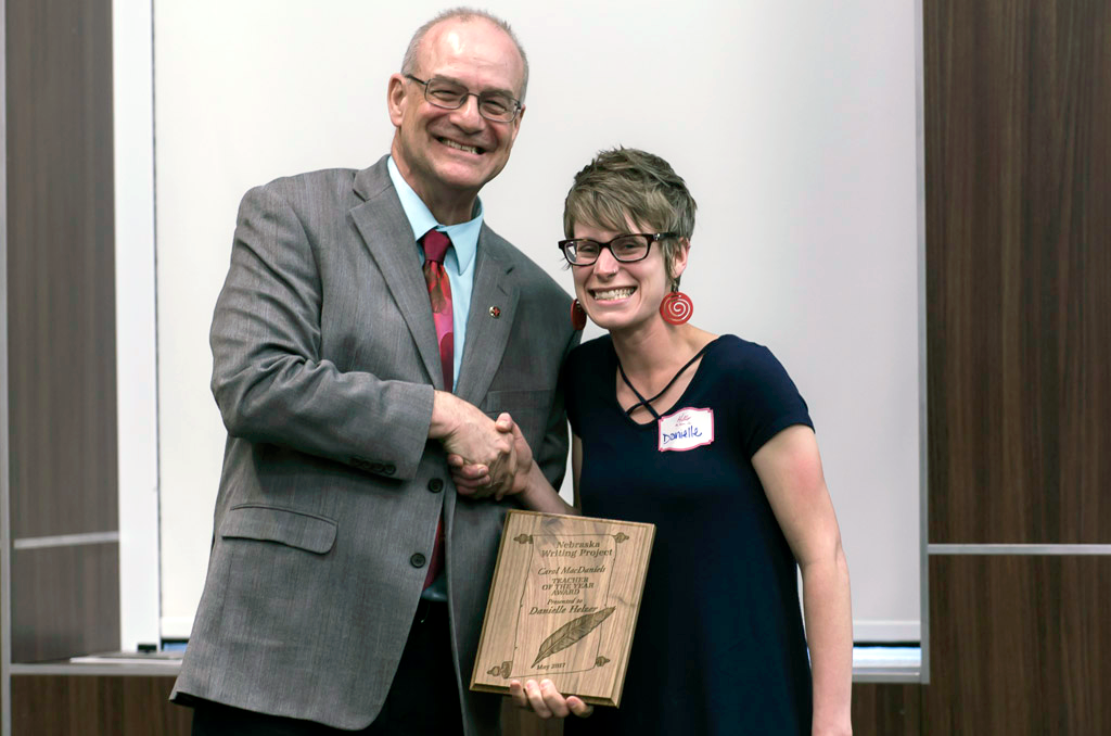 Director Robert Brooke presents the award to Danielle Helzer at the 2017 Spring Gathering