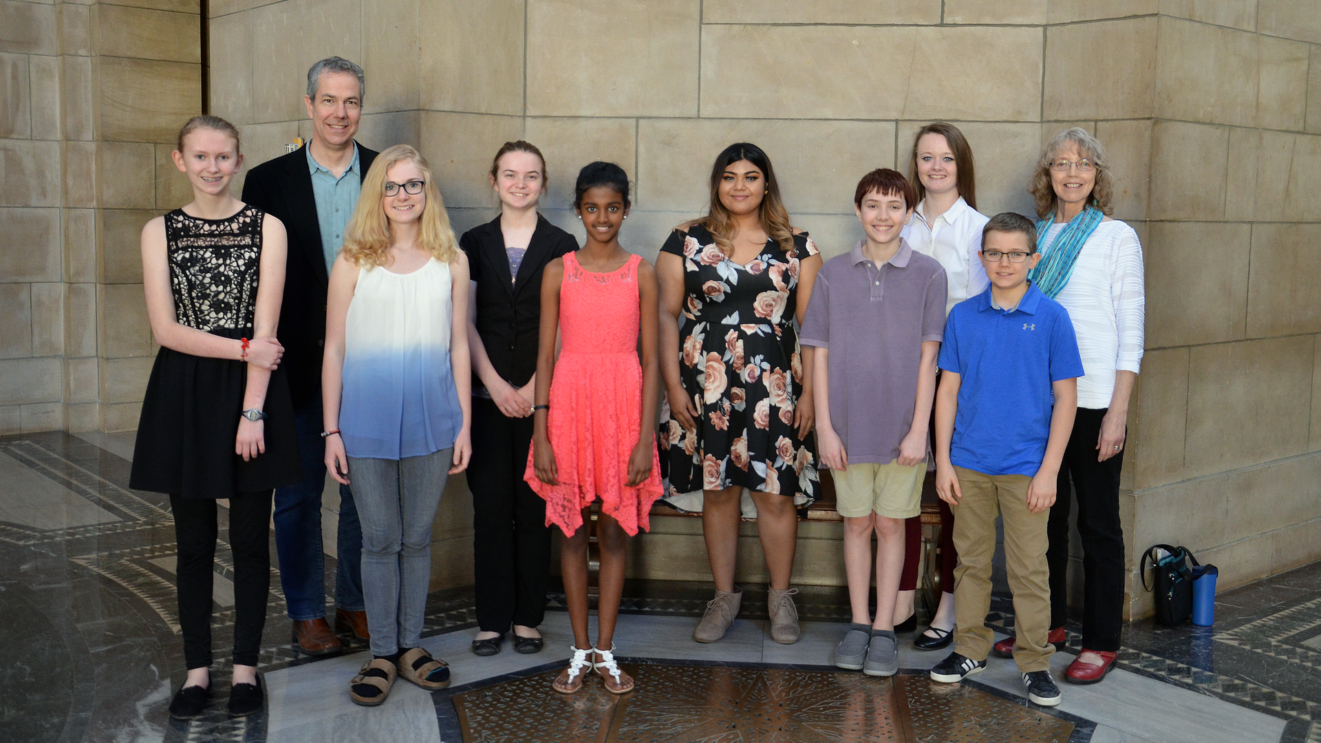 Poetry of Place winners pose in the State Capitol rotunda with poets Matt Mason and Twyla Hansen