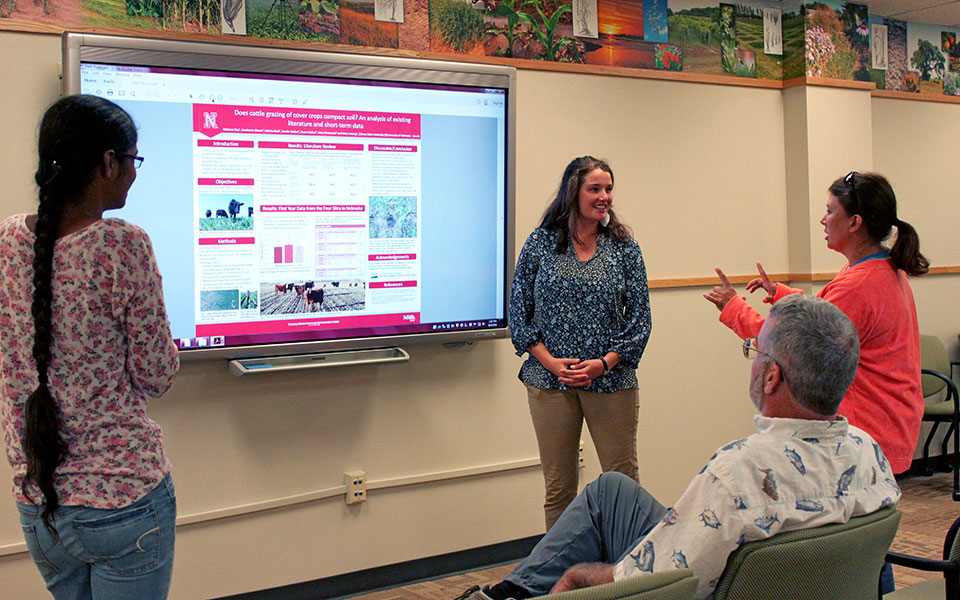 Becca Clay, an undergraduate from Iowa State University, presents her research poster on how grazing cover crops impact soil properties at the Goodding Learning Center, Plant Sciences Hall, UNL East Campus.